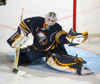 BUFFALO, NY - MARCH 30:  Jhonas Enroth #1 of the Buffalo Sabres makes a glove save against the New York Rangers at HSBC Arena on March 30, 2011 in Buffalo, New York.  (Photo by Rick Stewart/Getty Images)