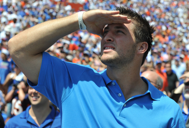 GAINESVILLE, FL - APRIL 9:  Tim Tebow watches a scoreboard as life-size statues of the Florida Gators three Heisman trophy winners are unvelied at halftime of the Orange and Blue spring football game April 9, 2011 Ben Hill Griffin Stadium at Gainesville,