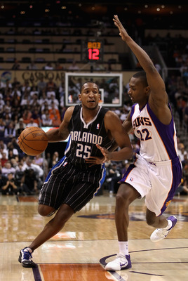 PHOENIX, AZ - MARCH 13:  Chris Duhon #25 of the Orlando Magic handles the ball during the NBA game against the Phoenix Suns at US Airways Center on March 13, 2011 in Phoenix, Arizona. The Magic defeated the Suns 111-88. NOTE TO USER: User expressly acknow