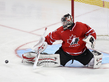BUFFALO, NY - JANUARY 03: Mark Visentin #30 of Canada makes a save against the United States  during the 2011 IIHF World U20 Championship Semi Final game between United States and Canada on January 3, 2011 in Buffalo, New York.  (Photo by Rick Stewart/Get