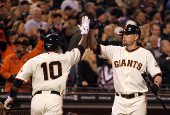 SAN FRANCISCO, CA - MAY 11:  Miguel Tejada #10 of the San Francisco Giants is congratulated by Aubrey Huff #17 of the San Francisco Giants after he scored the go ahead run in the sixth inning against the Arizona Diamondbacks at AT&T Park on May 11, 2011 i