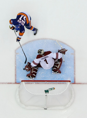 UNIONDALE, NY - DECEMBER 18:  Frans Nielsen #51 of the New York Islanders scores a shootout goal against Jason LaBarbara #1 of the Phoenix Coyotes during their game on December 18, 2010 at the Nassau Coliseum in Uniondale, New York.  (Photo by Al Bello/Ge