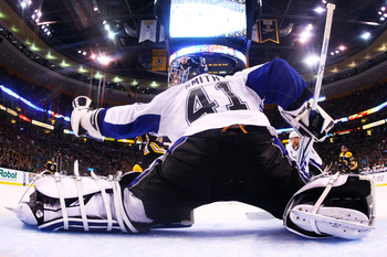 BOSTON, MA - MAY 23:  Mike Smith #41 of the Tampa Bay Lightning reaches for a first period glove save in Game Five of the Eastern Conference Finals against the Boston Bruins during the 2011 NHL Stanley Cup Playoffs at TD Garden on May 23, 2011 in Boston,