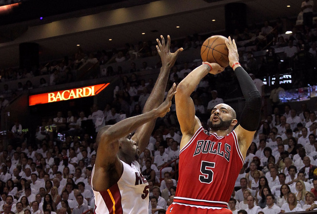 MIAMI, FL - MAY 22:  Carlos Boozer #5 of the Chicago Bulls attempts a shot against Joel Anthony #50 of the Miami Heat in Game Three of the Eastern Conference Finals during the 2011 NBA Playoffs on May 22, 2011 at American Airlines Arena in Miami, Florida.