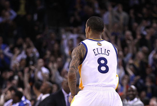 OAKLAND, CA - JANUARY 19:  Monta Ellis #8 of the Golden State Warriors runs back downcourt after he made the winning shot with 0.6 seconds left in their game againsts the Indiana Pacers at Oracle Arena on January 19, 2011 in Oakland, California.  NOTE TO