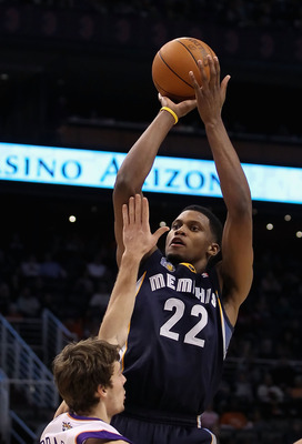 PHOENIX - DECEMBER 08:  Rudy Gay #22 of the Memphis Grizzlies puts up a shot against the Phoenix Suns during the NBA game at US Airways Center on December 8, 2010 in Phoenix, Arizona. NOTE TO USER: User expressly acknowledges and agrees that, by downloadi