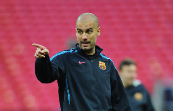LONDON, ENGLAND - MAY 27:  Josep Guardiola manager of FC Barcelona gives instructions during a Barcelona training session prior to the UEFA Champions League final versus Manchester United at Wembley Stadium on May 27, 2011 in London, England.  (Photo by J