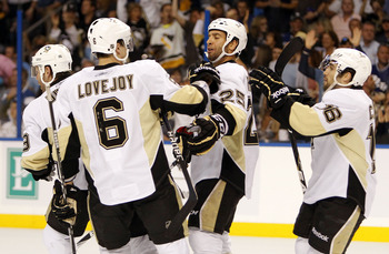 TAMPA, FL - APRIL 18: Maxime Talbot #25 of the Pittsburgh Penguins celebrates a goal with teammates against the Tampa Bay Lightning in Game Three of the Eastern Conference Quarterfinals during the 2011 NHL Stanley Cup Playoffs at the St. Pete Times Forum