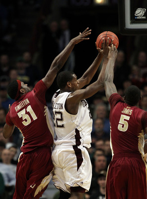 CHICAGO, IL - MARCH 18:  Khris Middleton #22 of the Texas A&M Aggies shoots against Chris Singleton #31 and Bernard James #5 of the Florida State Seminoles in the second half during the second round of the 2011 NCAA men's basketball tournament at the Unit