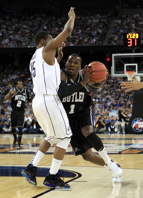HOUSTON, TX - APRIL 04:  Shelvin Mack #1 of the Butler Bulldogs drives on Kemba Walker #15 of the Connecticut Huskies during the National Championship Game of the 2011 NCAA Division I Men's Basketball Tournament at Reliant Stadium on April 4, 2011 in Hous