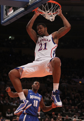 NEW YORK, NY - DECEMBER 07:  Markieff Morris #21 of the Kansas Jayhawks dunks the ball against the Memphis Tigers during their game at the Jimmy V Classic at Madison Square Garden on December 7, 2010 in New York City.  (Photo by Nick Laham/Getty Images)