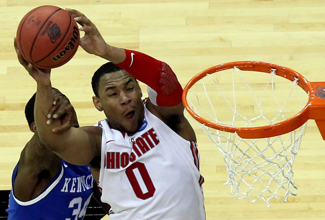 NEWARK, NJ - MARCH 25:  Jared Sullinger #0 of the Ohio State Buckeyes goes for a lay up against DeAndre Liggins #34 of the Kentucky Wildcats during the second half of the east regional semifinal of the 2011 NCAA Men's Basketball Tournament at the Prudenti