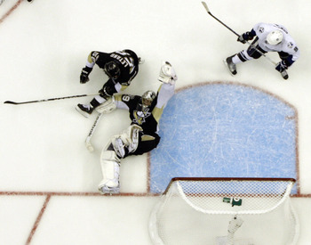 PITTSBURGH, PA - APRIL 27:  Marc-Andre Fleury #29 of the Pittsburgh Penguins makes a glove save against the Tampa Bay Lightning in Game Seven of the Eastern Conference Quarterfinals during the 2011 NHL Stanley Cup Playoffs at Consol Energy Center on April