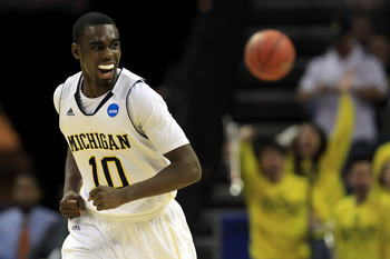 CHARLOTTE, NC - MARCH 18:  Tim Hardaway Jr. #10 of the Michigan Wolverines reacts in the second half while taking on the Tennessee Volunteers during the second round of the 2011 NCAA men's basketball tournament at Time Warner Cable Arena on March 18, 2011