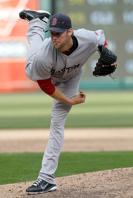 ARLINGTON, TX - APRIL 01:  Daniel Bard #51 of the Boston Red Sox pitches against the Texas Rangers on Opening Day at Rangers Ballpark in Arlington on April 1, 2011 in Arlington, Texas.  (Photo by Tom Pennington/Getty Images)