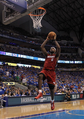 DALLAS, TX - JUNE 05:  LeBron James #6 of the Miami Heat dunks the ball on a breakaway in the second half while taking on the Dallas Mavericks in Game Three of the 2011 NBA Finals at American Airlines Center on June 5, 2011 in Dallas, Texas.  NOTE TO USER