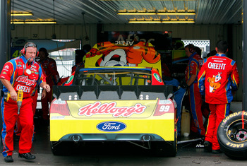 LONG POND, PA - JUNE 12:  Carl Edwards, driver of the #99 Kellogg's Ford, sits in the garage with engine trouble during the NASCAR Sprint Cup Series 5-Hour Energy 500 at Pocono Raceway on June 12, 2011 in Long Pond, Pennsylvania.  (Photo by Jeff Zelevansk