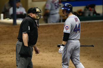 MILWAUKEE, WI - JUNE 8: Jason Bay #44 of the New York Mets argues with umpire Bruce Dreckman #1 after a third strike call during the game against the Milwaukee Brewers at Miller Park on June 8, 2011 in Milwaukee, Wisconsin. (Photo by Scott Boehm/Getty Ima