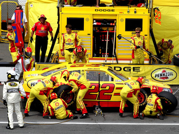 LONG POND, PA - JUNE 12:  Kurt Busch, driver of the #22 Shell/Pennzoil Dodge, makes a pit stop during the NASCAR Sprint Cup Series 5-Hour Energy 500 at Pocono Raceway on June 12, 2011 in Long Pond, Pennsylvania.  (Photo by Jerry Markland/Getty Images for