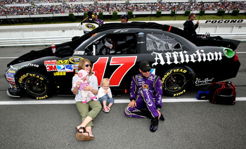 LONG POND, PA - JUNE 12:  Matt Kenseth, driver of the #17 Affliction Clothing: Live Fast Ford, talks with his wife Katie and daughters Kaylin and Grace prior to the start of the NASCAR Sprint Cup Series 5-Hour Energy 500 at Pocono Raceway on June 12, 2011