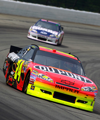 LONG POND, PA - JUNE 12:  Jeff Gordon, driver of the #24 DuPont Chevrolet, leads Dale Earnhardt Jr., driver of the #88 National Guard/Amp Energy Chevrolet, during the NASCAR Sprint Cup Series 5-Hour Energy 500 at Pocono Raceway on June 12, 2011 in Long Po