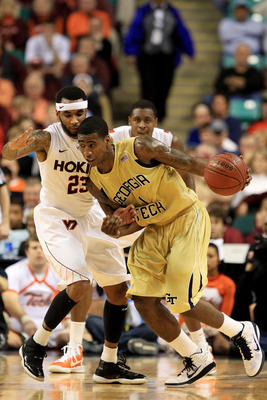 GREENSBORO, NC - MARCH 10:  Iman Shumpert #1 of the Georgia Tech Yellow Jackets drives against Malcolm Delaney #23 of the Virginia Tech Hokies during the first half of the game in the first round of the 2011 ACC men's basketball tournament at the Greensbo