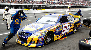 LONG POND, PA - JUNE 12: Martin Truex Jr., driver of the #56 NAPA Auto Parts Toyota, comes in for a pit stop during the NASCAR Sprint Cup Series 5-Hour Energy 500 at Pocono Raceway on June 12, 2011 in Long Pond, Pennsylvania.  (Photo by Jeff Zelevansky/Ge