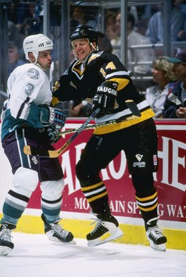 25 Sep 1996:  Rightwinger Brad Lauer of the Pittsburgh Penguins (right) and Anaheim Mighty Ducks defenseman Jason York tangle up during a game at Arrowhead Pond in Anaheim, California.  The Ducks won the game, 6-1. Mandatory Credit: Glenn Cratty  /Allspor