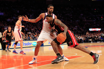 NEW YORK, NY - JANUARY 27:  LeBron James #6 of the Miami Heat drives past Shawne Williams #3 of the New York Knicks at Madison Square Garden on January 27, 2011 in New York City. NOTE TO USER: User expressly acknowledges and agrees that, by downloading an