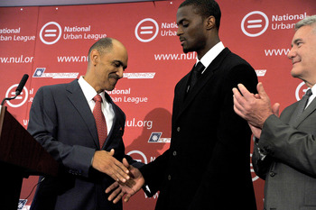 NEW YORK, NY - JUNE 13: (L-R) Former NFL football coach Tony Dungy shakes hands with former NFL wide reciever Plaxico Burress during a press conference  at National Urban League on June 13, 2011 in New York City.  (Photo by Joe Corrigan/Getty Images)