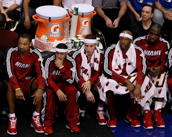 DALLAS, TX - JUNE 05:  (L-R) Juwan Howard #5, Eddie House #55, Mike Bibby #0, Erick Dampier #25, Joel Anthony #50 and LeBron James #6 of the Miami Heat sit on the bench while taking on the Dallas Mavericks in Game Three of the 2011 NBA Finals at American
