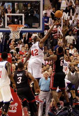 PHILADELPHIA, PA - APRIL 24:  Elton Brand #42 of the Philadelphia 76ers blocks a last second shot by LeBron James #6 of the Miami Heat during the second half of the Game Four of the Eastern Conference Quarterfinals in the 2011 NBA Playoffs at Wells Fargo