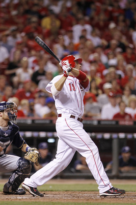 CINCINNATI, OH - JUNE 1: Joey Votto #19 of the Cincinnati Reds follows through on a two-run home run in the eighth inning against the Milwaukee Brewers at Great American Ball Park on June 1, 2011 in Cincinnati, Ohio. The Reds defeated the Brewers 4-3. (Ph