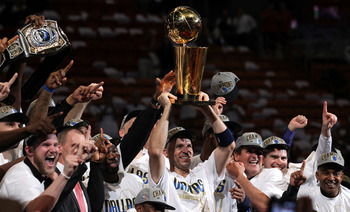MIAMI, FL - JUNE 12:  Jason Kidd #2 of the Dallas Mavericks holds the Larry O'Brien trophy after the Mavericks won 105-95 against the Miami Heat in Game Six of the 2011 NBA Finals at American Airlines Arena on June 12, 2011 in Miami, Florida. NOTE TO USER