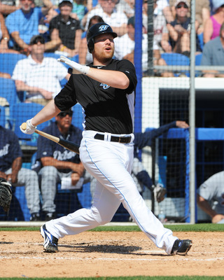 DUNEDIN, FL - FEBRUARY 26:  Infielder Adam Lind #26 of the Toronto Blue Jays bats against the Detroit Tigers February 26, 2011 at Florida Auto Exchange Stadium in Dunedin, Florida.  (Photo by Al Messerschmidt/Getty Images)