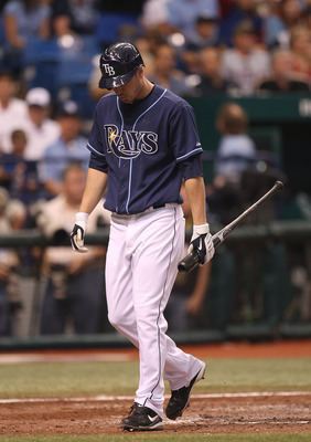 ST PETERSBURG, FL - OCTOBER 07: Matt Joyce #20 of the Tampa Bay Rays walks to the dugout after striking out during Game 2 of the ALDS against the Texas Rangers at Tropicana Field on October 7, 2010 in St. Petersburg, Florida.  (Photo by Mike Ehrmann/Getty