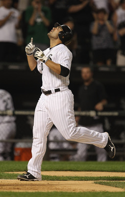 CHICAGO, IL - JUNE 08: Carlos Quentin #20 of the Chicago White Sox celebrates a two-run home run in the 8th inning, his second home run of the game, to force a tie against the Seattle Mariners at U.S. Cellular Field on June 8, 2011 in Chicago, Illinois. T