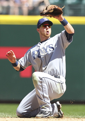SEATTLE - JUNE 04:  Second baseman Ben Zobrist #18 of the Tampa Bay Rays spears a line drive by Chone Figgins #9 of the Seattle Mariners at Safeco Field on June 4, 2011 in Seattle, Washington. The Rays defeated the Mariners 3-2. (Photo by Otto Greule Jr/G