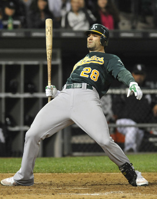 CHICAGO, IL - JUNE 11: Conor Jackson # 28 of the Oakland Athletics gets out of the way of an inside pitch against the Chicago White Sox  on June 11, 2011 at U.S. Cellular Field in Chicago, Illinois. The Sox defeated the Athletics 3-2.  (Photo by David Ban