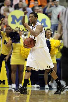 INDIANAPOLIS, IN - MARCH 11:  Darius Morris #4 of the Michigan Wolverines reacts against the Illinois Fighting Illini during the quarterfinals of the 2011 Big Ten Men's Basketball Tournament at Conseco Fieldhouse on March 11, 2011 in Indianapolis, Indiana
