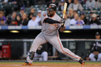DENVER, CO - APRIL 19:  Pablo Sandoval #48 of the San Francisco Giants begins his swing as he connects on a three run homerun off of starting pitcher Ubaldo Jimenez #38 of the Colorado Rockies in the first inning at Coors Field on April 19, 2011 in Denver