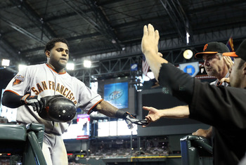 PHOENIX, AZ - APRIL 17:  Pablo Sandoval #48 of the San Francisco Giants high fives manager Bruce Bochy after Sandoval hit a solo home run against the Arizona Diamondbacks during the sixth inning of the Major League Baseball game at Chase Field on April 17