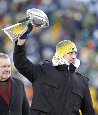 GREEN BAY, WI - FEBRUARY 08:  Green Bay Packers quarterback Aaron Rodgers hoists the Lombardi Trophy during the Packers victory ceremony at Lambeau Field on February 8, 2011 in Green Bay, Wisconsin.  (Photo by Matt Ludtke/Getty Images)
