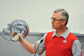 COLUMBUS, OH - MARCH 30:  Head Coach Jim Tressel shows off a football helmet with military camouflage to the media during a press conference before the start of Spring practices at the Woody Hayes Athletic Center at The Ohio State University on March 30,