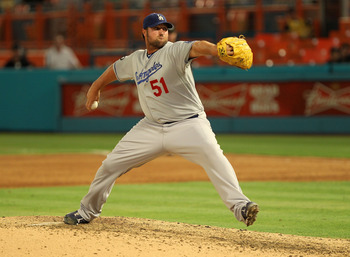MIAMI GARDENS, FL - APRIL 25:  Jonathan Broxton #51 of the Los Angeles Dodgers pitches during a game against the Florida Marlins at Sun Life Stadium on April 25, 2011 in Miami Gardens, Florida.  (Photo by Mike Ehrmann/Getty Images)
