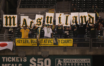 OAKLAND, CA - MAY 27:  Hideki Matsui fans of the Oakland Athletics cheer against the Baltimore Orioles during a Major League Baseball game at the Oakland-Alameda County Coliseum on May 27, 2011 in Oakland, California.  (Photo by Jed Jacobsohn/Getty Images