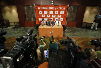 AUSTIN, TX - JUNE 15:  University of Texas at Austin President William Powers Jr., center, Women's Athletics Director Chris Plonskon, left, and Men's Athletics Director DeLoss Dodds, right, announce the athletics programs will continue competing in the Bi