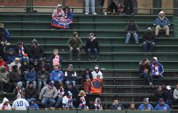 CHICAGO, IL - APRIL 20: Fans of the Chicago Cubs watch from the right field bleachers as the Cubs take on the San Diego Padres at Wrigley Field on April 20, 2011 in Chicago, Illinois. The Cubs defeated the Padres 2-1 in 11 innings. (Photo by Jonathan Dani