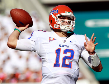 JACKSONVILLE, FL - OCTOBER 30:  Quarterback John Brantley #12 of the Florida Gators attempts a pass during the game against the Georgia Bulldogs at EverBank Field on October 30, 2010 in Jacksonville, Florida.  (Photo by Sam Greenwood/Getty Images)