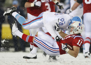FOXBORO, MA - OCTOBER 18:  Julian Edelman #11 of the New England Patriots is tackled by Dave Ball #98 of the Tennessee Titans on October 18, 2009 at Gillette Stadium in Foxboro, Massachusetts.The Patriots defeated the Titans 59-0.  (Photo by Elsa/Getty Im